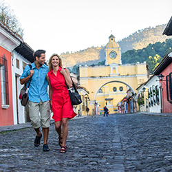Visitors walk through the cobblestone streets of Antigua, Guatemala. // © 2014 INGUAT