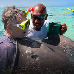 <p>The writer (left) up close with stingrays // © 2016 Cameron Longshaw</p><p>Feature image (above): Wind Spirit sails to several islands in French...