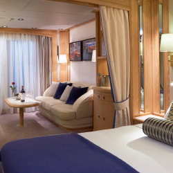 <p>Balcony Suites onboard Windstar's Star Legend are 277 square feet and feature a French balcony. // © 2016 Windstar Cruises</p><p>Feature image...