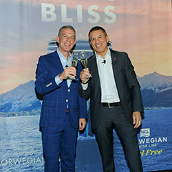 <p>Radio personality Elvis Duran (left) with Andy Stuart of Norwegian Cruise Line // © 2018 Norwegian Cruise Line</p><p>Feature image (above):...