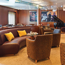 <p>The lounge onboard Regent's Navigator // © 2015 Regent Seven Seas Cruises</p><p>Feature image (above): Regent's 490-guest Navigator will visit 62...