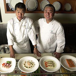 Chef Tamba (left) with Chef Nobu Matsuhisa preparing food on a Crystal Cruises' ship. // c 2013 Crystal Cruises