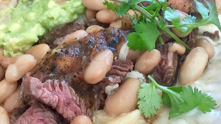 The Norteno taco at Corazon Cocina in Santa Barbara is filled with grilled skirt steak, cheese, guacamole and white beans.