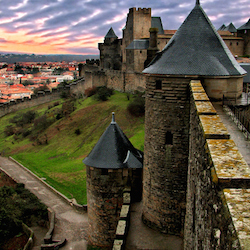 <p>Walking in the walled city of Carcassonne, France, is an included shore excursion on select Barcelona to Civitavecchia itineraries. // © 2015...