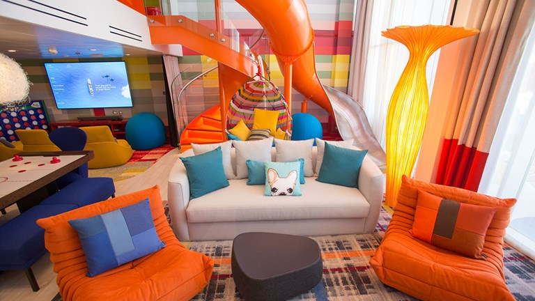 The 1,346-square-foot Ultimate Family Suite can accommodate up to eight people and features a slide between levels.