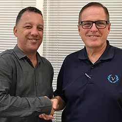 <p>A.D. Albertini, chairman of Aries Transporte S.A. (left), congratulates Victory Cruise Lines' Bruce Nierenberg on a berth agreement for 2018. Aries...