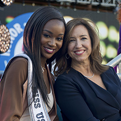 <p>Deshauna Barber (left), the first woman serving in the U.S. military to win the title of Miss USA, is the godmother of Carnival Vista. // © 2016...