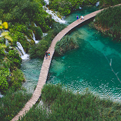 "<p>Deemed ""Croatia's Eden,"" Plitvice Lakes National Park is famous for its boardwalks and waterfalls. // © 2018 Creative Commons user <a..."