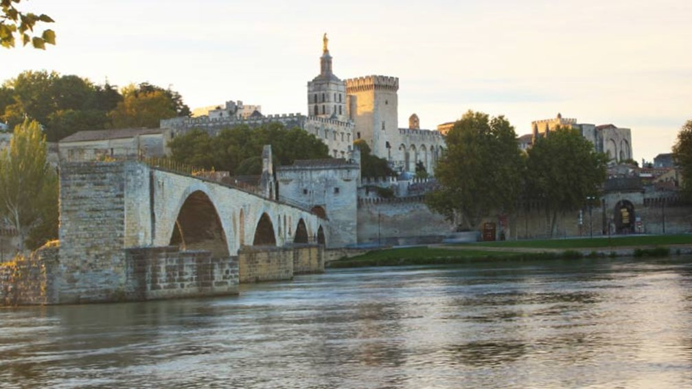 view of Avignon Bridge on the Rhone River with the Papal Palace in the distance // © 2015 iStock 2