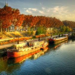 <p>River barges docked along the Saone River // © 2015 iStock</p><p>Feature image (above): view of Avignon Bridge on the Rhone River with the Papal...