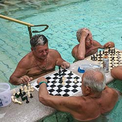 <p>A group of local Hungarian men meet regularly at Szechenyi to play chess in the healing waters. // © 2016 Josalin Saffer</p><p>Feature image...
