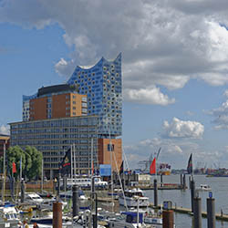 <p>The recently opened Elbphilharmonie features a spiked roof meant to resemble a ship's sails.  // © 2017 Creative Commons user <a...