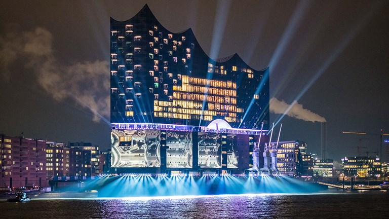 Elbphilharmonie lights up at night.