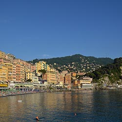 "<p>Camogli's colorful seaside buildings and beach // © 2017 Creative Commons user <a href=""https://www.flickr.com/photos/sun_sand_sea/18211192303""..."