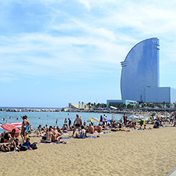 <p>Barceloneta Beach attracts both tourists and locals alike. // © 2016 iStock</p><p>Feature image (above): Watch the Magic Fountain dance in a...