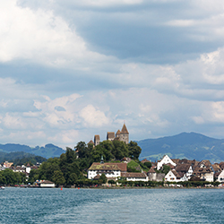 <p>Rapperswil Castle sits at the top of a hill at the point of town and has been reconstructed several times since its initial foundation in the 12th...