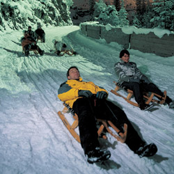 <p>Sledging, or sledding, is a traditional pastime in Switzerland. // © 2015 Bob Ecker</p><p>Feature image (above): Riders hold a rope while sledging...
