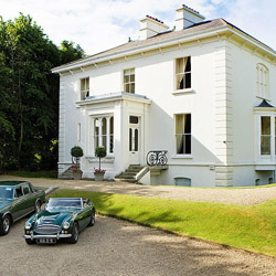 <p>Elegant rooms, lawn games and an on-site cinema await at Rosedale House, which is a 25-minute drive from Dublin. // © 2015 Rosedale...