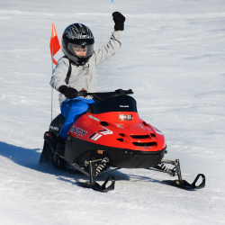 Okemo's snowmobile tours are designed specially for kids. // © 2015 Okemo Mountain Resort