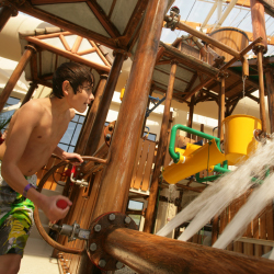 The new indoor waterpark offers waterslide fun year-round. // © 2015 Camelback Lodge & Aquatopia Indoor Waterpark