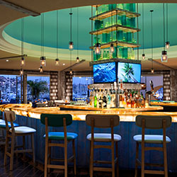 <p>Vessel Restaurant's renovation includes a 360-degree central bar and a video wall showcasing local landscapes. // © 2017 Samantha...