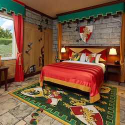 <p>A kingdom-themed room at Legoland Hotel // © 2015 Legoland Hotel</p><p>Feature image (above): Emmet from 'The Lego Movie' helps in the construction...