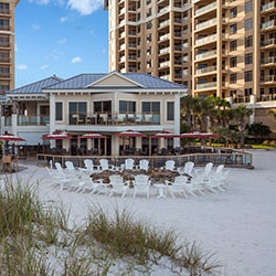 <p>Family-friendly dining options at Sandpearl Resort Clearwater Beach include Tate Island Grill, which has a children's menu. // © 2016 Sandpearl...