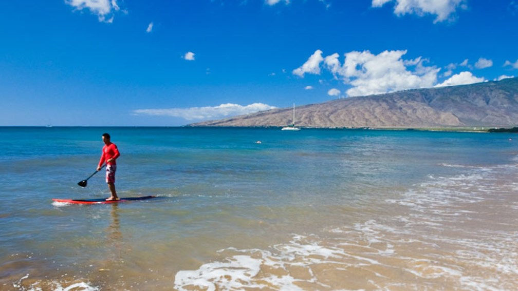 Kihei offers guests access to watersports such as stand-up paddleboarding. // © 2015 Maui Visitors and Convention Bureau 2