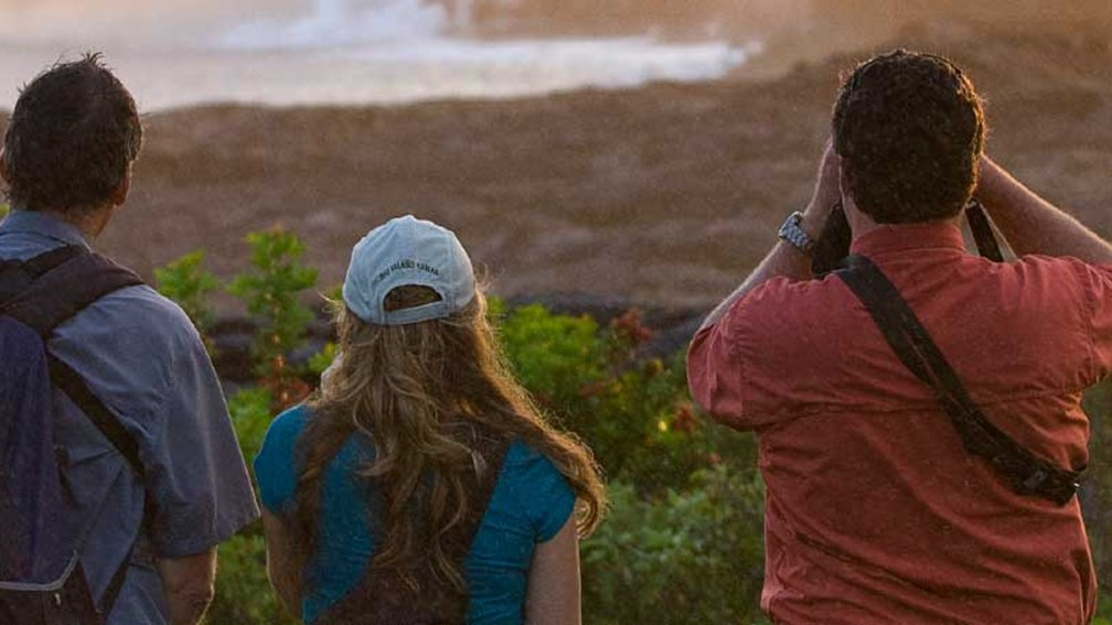 Visitors can watch lava spill into the ocean on HF&T's Twilight Volcano Adventure. // © 2014 Hawaii Forest and Trail 2
