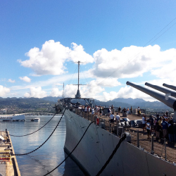 At Pearl Harbor, the bow of the Battleship Missouri Memorial points toward the Arizona Memorial. // © 2014 Battleship Missouri Memorial