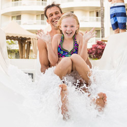 <p>A waterslide connects two family pools at Fairmont Kea Lani Maui. // © 2015 Fairmont Kea Lani</p><p>Feature image (above): Hyatt Maui guests can...