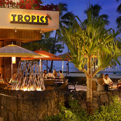 Established in 1987 and featured on Hawaii Five-O, Tropics Bar and Grill is an iconic bar of Waikiki. // © Tropics Bar and Grill