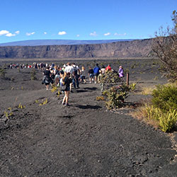 <p>A ranger leads a group of hikers onto the floor of Kilauea caldera in Hawaii Volcanoes National // © 2016 National Park Service</p><p>Feature image...