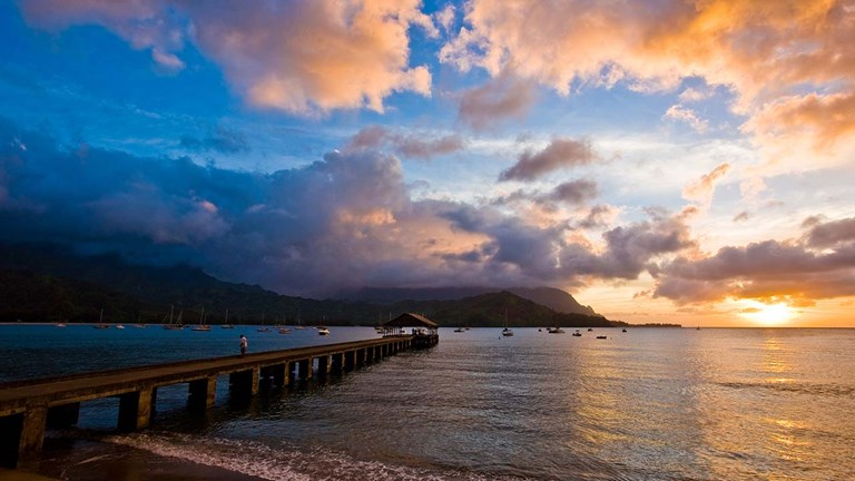 Hawaii's charm, shaped by photogenic locations such as Kauai's Hanalei Bay (pictured here), remains attractive to North American travelers.