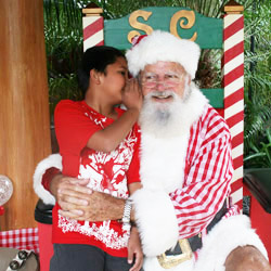 <p>Children share their Christmas wish list during the Breakfast with Santa event at Outrigger Reef on the Beach. // © 2014 Outrigger...