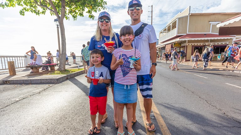 During the July 4 festivities in Lahaina, Maui, a family celebrates with face paint and Hawaiian shave ice.