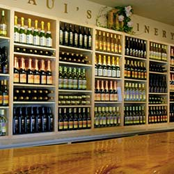 <p>Belly up to the mango wood bar and sample distinctive island wines at Maui's Winery. // © 2014 Maui's Winery</p><p>Feature image (above):...