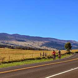 <p>Two-wheeling down Maui's Haleakala volcano gives visitors a keen sense of its size. // © 2015 Maui Sunriders</p><p>Feature image (above): Clients...