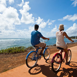 A coastal bike path is one of many attractions in Kapaa, Kauai. © // 2014 HTA/Tor Johnson
