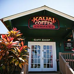 <p>A cheery visitor center awaits guests at Kauai Coffee Company. // © 2016 Kauai Coffee Company</p><p>Feature image (above): Kauai Coffee Company is...