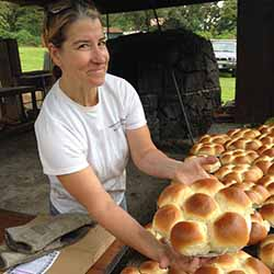 <p>Visitors can see and taste authentic Portuguese sweetbread baked in an outdoor stone oven. // © 2015 Marty Wentzel</p><p>Feature image (above): See...
