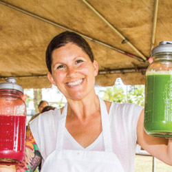 <p>Anuenue Juice Bar owner Tammy Ringbauer whips up smoothies from local fruits and veggies. // © 2014 Anuenue Juice Bar</p><p>Feature image (above):...