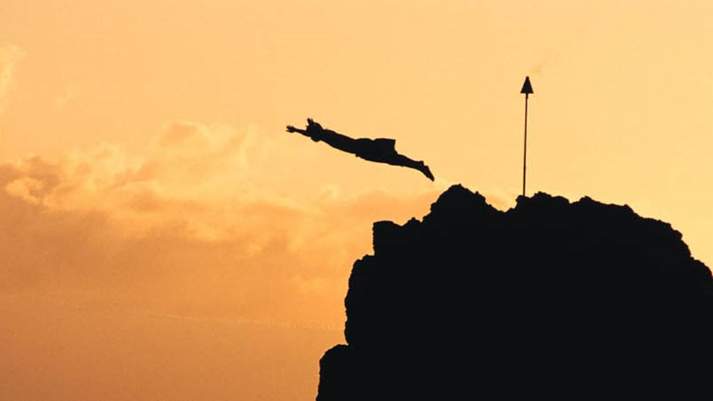 A cliff diver honors the last chief of Maui with a nightly sunset cliff dive off of Black Rock on Kaanapali Beach. // © 2013 Sheraton Maui Resort and Spa F