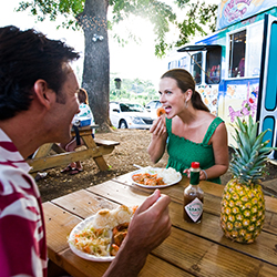 <p>The North Shore's food trucks specialize in fresh local shrimp. // © 2014 HTA/Tor Johnson</p><p>Feature image (above): Visitors can rise above it...