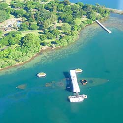 <p>Paradise Helicopters' circle-island tour provides views of Oahu landmarks such as the Arizona Memorial. // © 2016 Samantha...