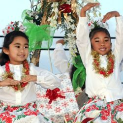 Hawaii Island hula girls celebrate the holidays during the Kailua-Kona Christmas parade. // © www.paradesinkona.com