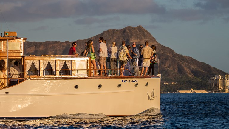 Vida Mia, a lovingly restored 1929 wooden yacht, presents a stylish venue for private charters off Oahu's shores.