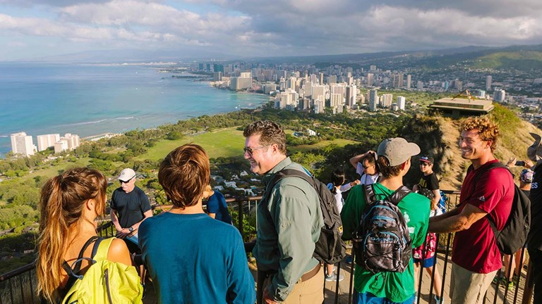 During Hawaii Forest & Trail's Honolulu Heights tour, guides share insights and inspirational views from the Diamond Head summit