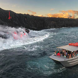 <p>Boat tours thrill clients with views of molten lava dripping into the sea. // © 2016 Seelava.com</p><p>Feature image (above): Tour operators lead...