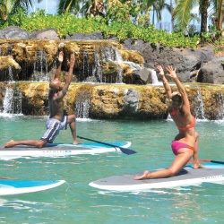 New SUP yoga classes are now available in Duke's Lagoon. // © 2014 Waikiki Beach Activities